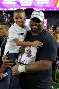 New England Patriots Vince Wilfork celebrates with his family after winning the NFL Super Bowl XLIX football game against the Seattle Seahawks on Sunday, Feb. 1, 2015, in Glendale, Ariz. (AP Photo/Gregory Payan)